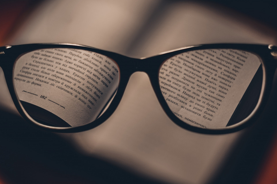 glasses magnifying text