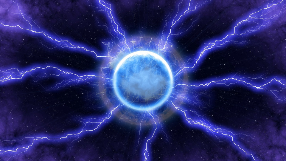 ball of light with radiating rays against purple blue background