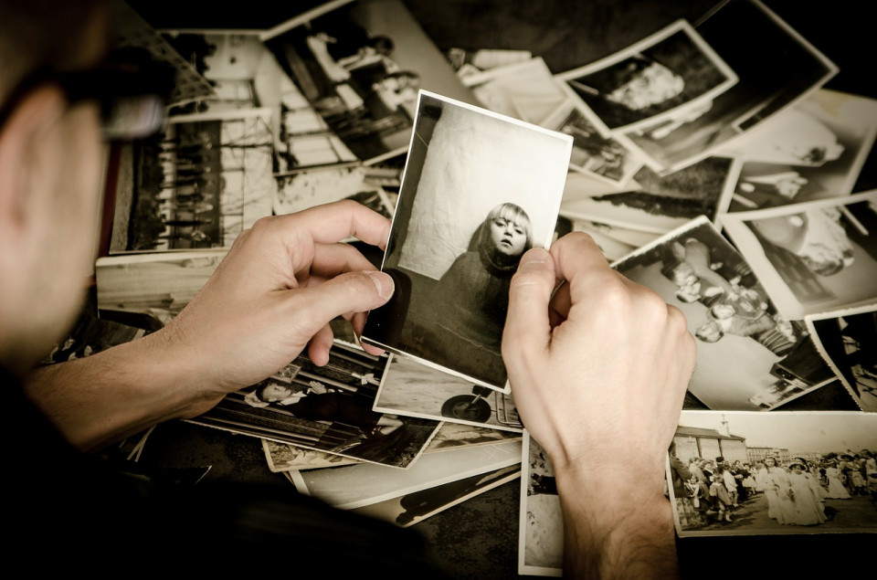 photo of hands holding photo