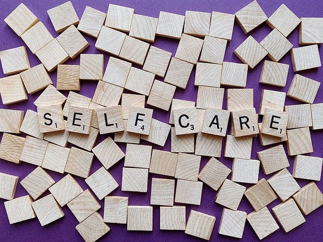 Scrabble tiles spelling SELF CARE Image by Wokandapix from Pixabay