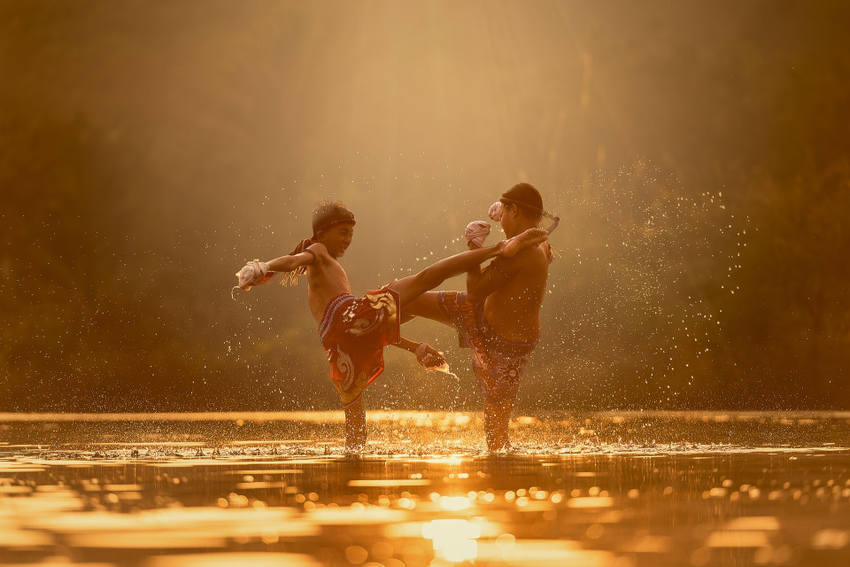 golden toned photo of boys kickboxing in water Image by Sasin Tipchai from Pixabay