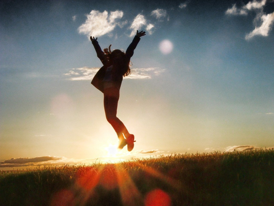 photo of woman jumping against sunset Image by Shad0wfall from Pixabay