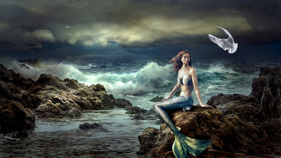 manipulated image of a mermaid on a rock in a storm Image by Stefan Keller from Pixabay