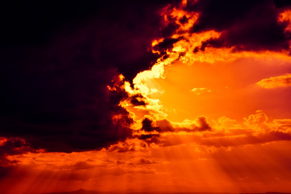 photo of sky with dark clouds and very red clouds