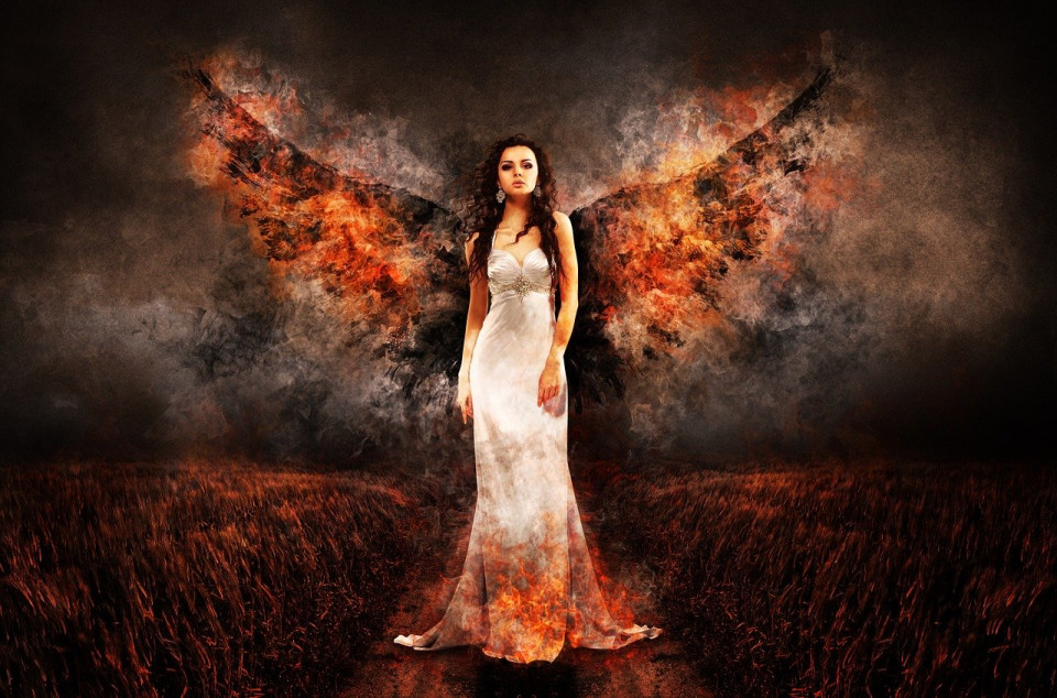 stylized photo of woman in white gown with fiery wings Image by Gerd Altmann from Pixabay