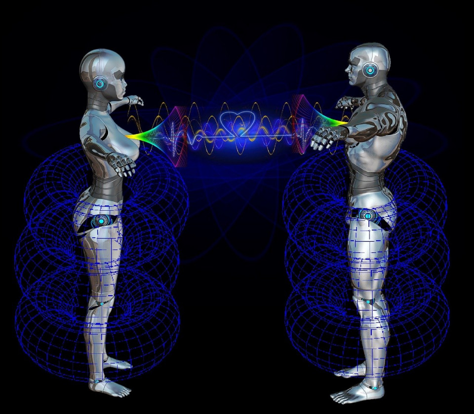 graphic of male & female robot figures facing each other with energy connecting their hearts Image by Karin Henseler from Pixabay