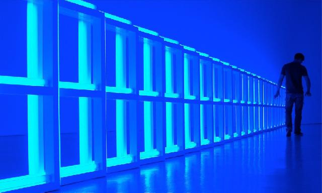 blue image of silhouetted figure walking down a corridor stock image from Jumpstory