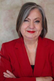 color photo of Kathy Biehl in red jacket