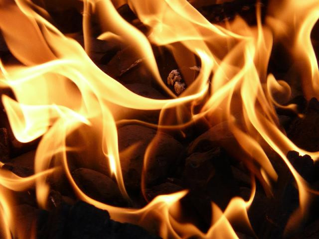photo of yellow flames close up with brown between the flames